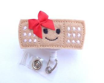 Badge Reel ID Holder Retractable - Stick it - Smiley face red bow - tan black white felt band aid - Nurse pediatrician
