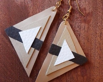 hand cut desert inspired southwestern geometric triangular neutral x polyurethane earrings.