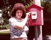 Vintage Photo, Woman Posing at Fire Box, Snapshot, Found Photo, Color Photo, Vernacular Photo, 1970's Fashion, Big Hair  AUGUSTINE0740