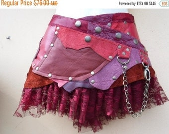 20%OFF 20 Percent OFF...BURNING Man festival ,  patchwork leather mini skirt/belt with ruffles and studs... 34'' to 42' hip or waist...