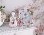 shabby chic picture frame perfume bottle italian hand made porcelain roses frame and boudoir vantiy bottle decor nuova capodimonte Lavastano