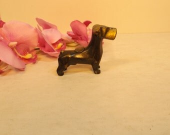 Small Bronze dog. Excellent  condition. Great home or office decor! Vintage.Mid Century.Library. Good on any shelf or desk.Gift