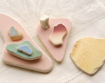 7 pastel sea smoothed ceramic pieces and 1 doll's feet (no.7)