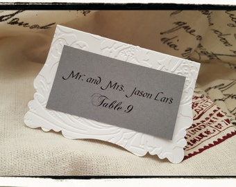 Embossed table name place cards