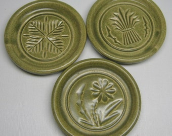 PIGEON FORGE POTTERY set of three coasters , butter mold / buttermold , vintage .