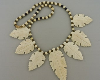 """Faux Ivory Leaves and Gold Tone and wood bead Necklace 16"""""""