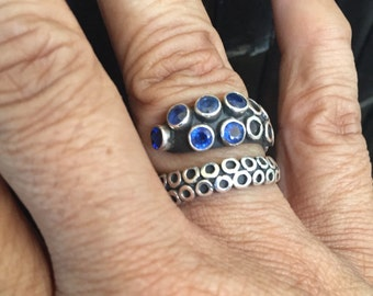 Reserve for Zee- Sterling octopus tentacle ring with inlaid sapphire