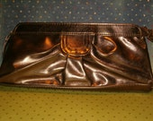 "Vintage 1980 Bronze Color Clutch Purse, Peach Color Lining, Pocket Inside, 10.5""L, 4.75""H, Zipper, Wrist Strap"