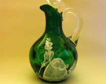 Vintage Cruet - Green glass Inverted Thumb print, Mary Gregory style, Girl in period dress playing croquet - clear stopper & handle