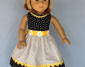 E18 inch doll dress and hair clip.  Fits American Girl Dolls.  Black and white dots with yellow contrast.