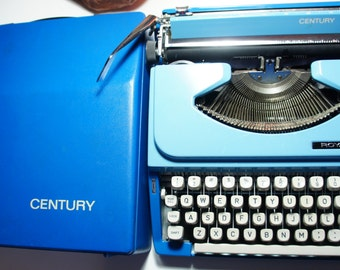 Beautiful Vintage blue Royal Century Portable Mechanical Typewriter with original case. Made in Japan.