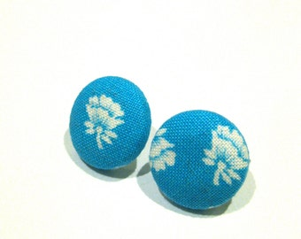 Bright turquoise button earrings with white flowers
