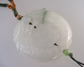 Vintage Carved Double Headed Dragon Jadeite Pendant on Knotted Cord.....  Lot 4509