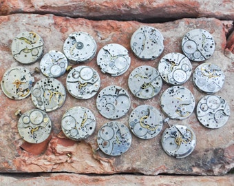 0.9 inch Set of 20 vintage wrist watch movements.