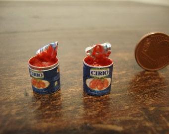 miniature cans tomato sauce, open 1 piece