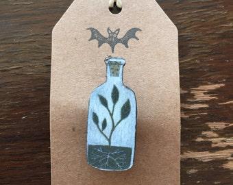 Plant in a bottle Brooch