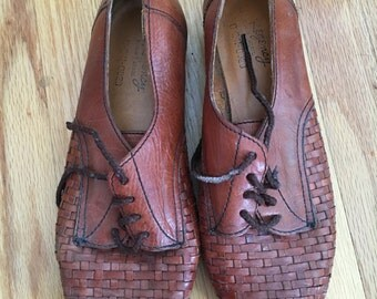 Woven brown leather oxford flats
