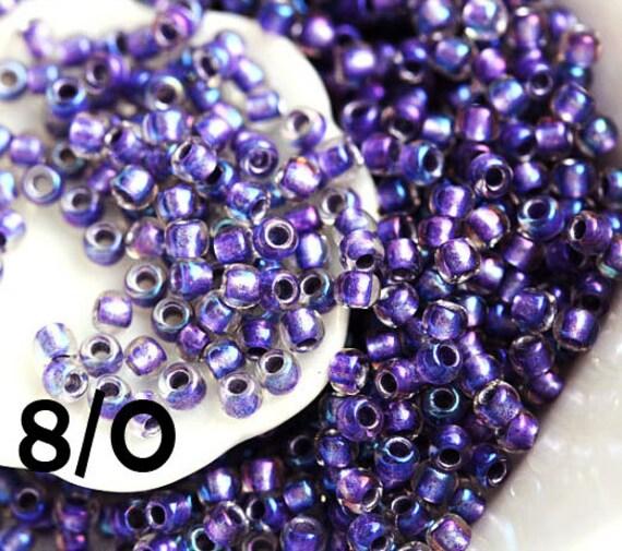 Purple seed beads toho seeds size 8 0 inside color rainbow crystal