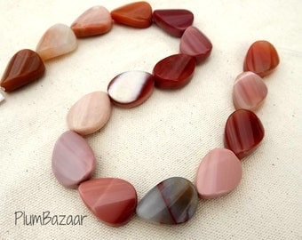 "Beautiful stone beads, large twisted teardrop shape, 16"" strand"