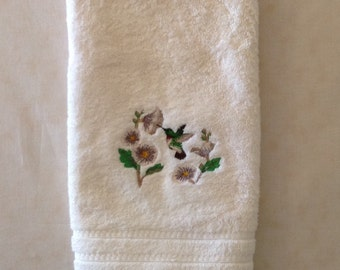 Elegant hummingbird machine embroidery on cream hand towel