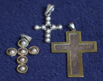 Three sterling silver crosses