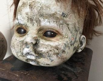 Creepy horror babydoll assemblage art doll on vintage coffee grinder