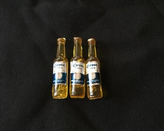 Set of three mini beer bottles