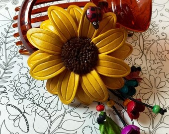 big leather sunflower with lady bug hair clip