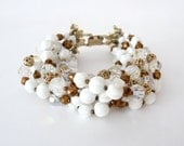 Signed Vendome Seven Strand Beaded Bracelet Milk Glass Beads Gold Tone Leaf Closure Vintage from TreasuresOfGrace