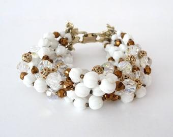 Signed Vendome Seven Strand Beaded Bracelet Milk Glass Beads Gold Tone Leaf Closure Vintage from TreasuresOfGrace