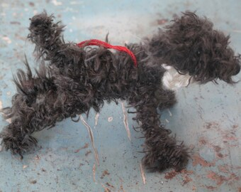 Mud-coloured scruffy dog decoration.