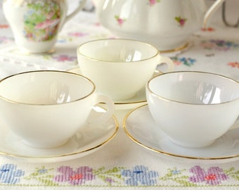 Vintage glass lustre cups and saucers by Arcopal France: set of 3 pastel cups and saucers from the 1960s