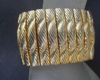Sleek Wide Gilt Metal Stretch Bracelet c 1970s