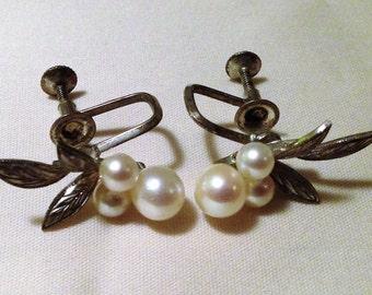 Vintage silver pearl screw back earrings.