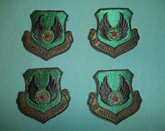 Four (4) AF Material Command Shoulder Patches, w Velcro Backing.