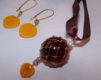"Crystal Ball Necklace and Earrings. ""Root Beer"" transluscent sphere with gold glass earrings and drop. 22"" Brown Silk Ribbon"
