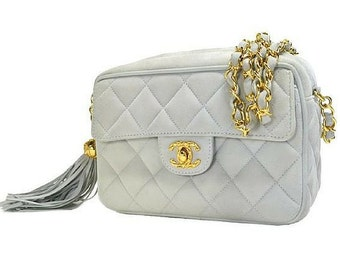 Vintage CHANEL quilted genuine suede leather light blue camera shoulder purse with golden chain strap and a fringe.