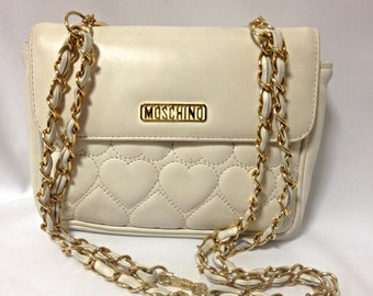 Vintage MOSCHINO white heart shape stitch lambskin shoulder purse with chain straps. Can be a hip bag and clutch handbag as well.