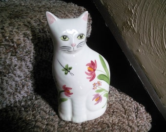 Cat Figurine with Floral Decor and Dragonfly