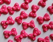 Hot pink polka dot bows -- Cupcake toppers cake decorations cake pops Minnie Mouse (12 pieces)