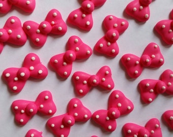 Hot pink polka dot bows: Made to order -- Edible cupcake toppers cake decorations cake pops Minnie Mouse (12 pieces)