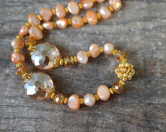 Peach Cultured Freshwater Pearl Necklace with Fancy Gold-Plated and Faceted Glass Beads