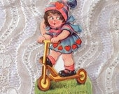Vintage Valentine Weird Little Girl on Scooter with Four Faces Romantic Greeting Card Hearts
