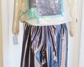 White, turquoise and grey long sleeved sequined nylon top with a sheer lining and grey metallic nylon and lycra stretch, stirrup pants,