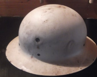 Vintage Civil defense helmet circa WW11 with strap liner, unique, rare with bullet holes