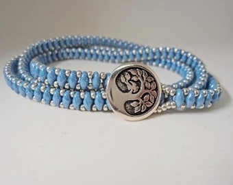 Triple wrap blue czech bead and silver toned japanese seed bead bracelet