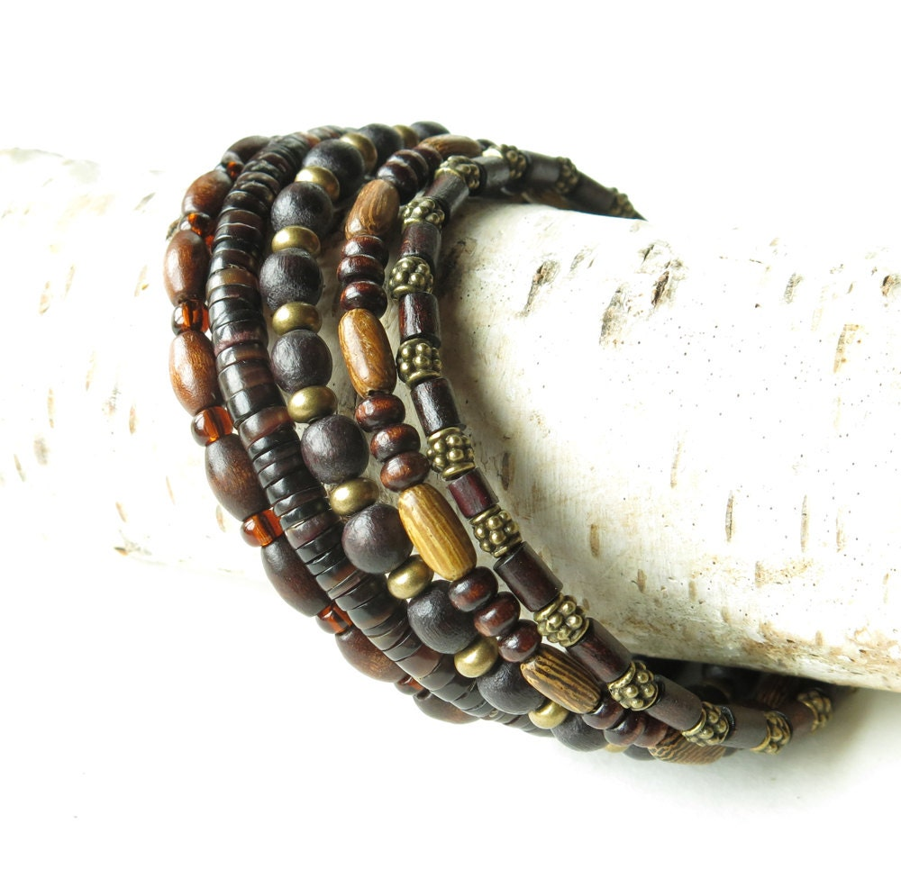 Stacked bead bracelets earthy brown wood shell glass