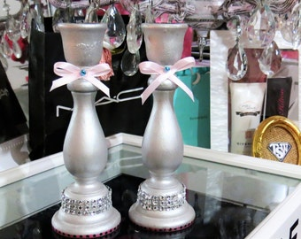 1 Set of 2 1 Pair of wooden silver painted candle holders decorated with cute pink bows and 2 Swarovski crystal elements