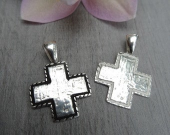 Sterling silver cross pendant. Equilibrium cross.