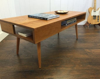 Thin Man mid century modern coffee table with storage, solid cherry.